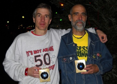 "Two ""over 50"" runners celebrating their award-winning races."