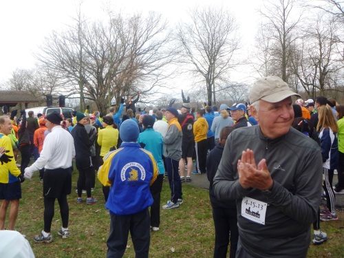 Randy Step (center, orange gloves) fires up the unity run crowd.