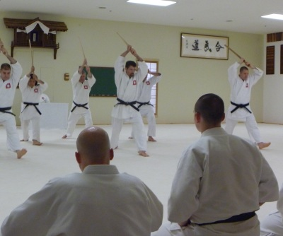 Our new Vermont dojo sensei (center) at a black belt test demonstration.