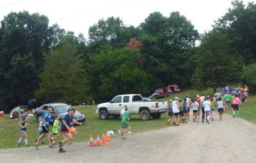 "The Woodstock Sunday morning runners head for the woods. (I heard a few ""Oh, my legs!"" but no one stopped running.)"