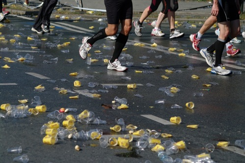 Water stop at the Berlin Marathon (Source: Wikimedia Commons.)