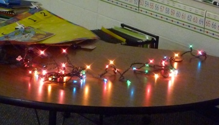 Christmas lights on a table under fluorescent lights Just not the same sense of mystery, if you ask me.