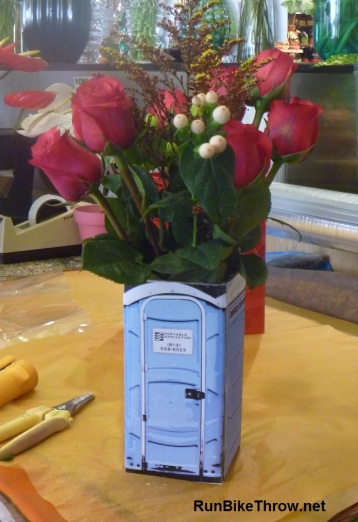 Flowers in Porta Potty Vase
