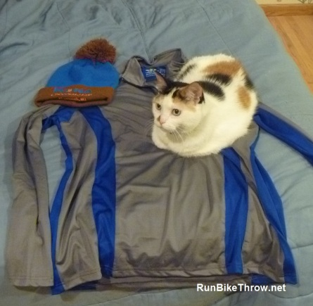 The half-zip is a nice upgrade over the standard race shirt. And it's cat-approved.