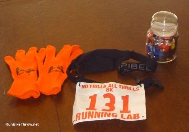 """No frills"" race swag: gloves, chipless bib, and age group award."