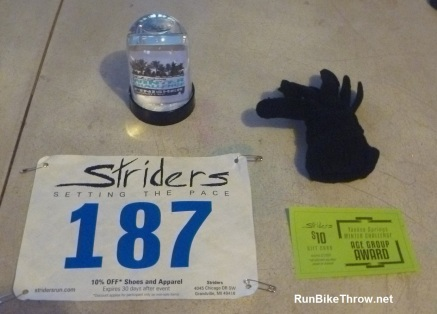 Swag: Finisher's snow globe and age group gloves + gift certificate.